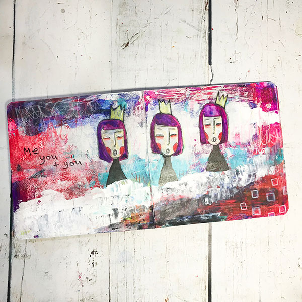 board book with colourful art journaling showing three feminine whimsical faces